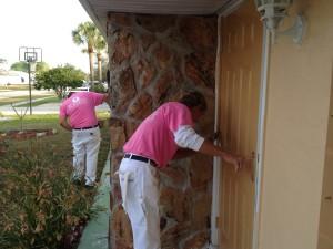 Super Hero Jimmy Paints the front door
